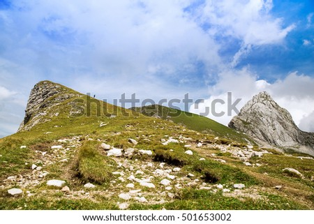 Nature landscape. Amazing view on Alps: valley and mountains at summer. Mangart is a mountain in the Julian Alps, located between Italy and Slovenia.