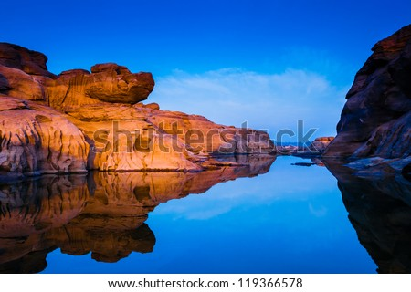 Nature Landscape view of Sand dunes and rock field with water reflection at Sam Phan Bok a canyon by the mekong river in grand canyon of Thailand.