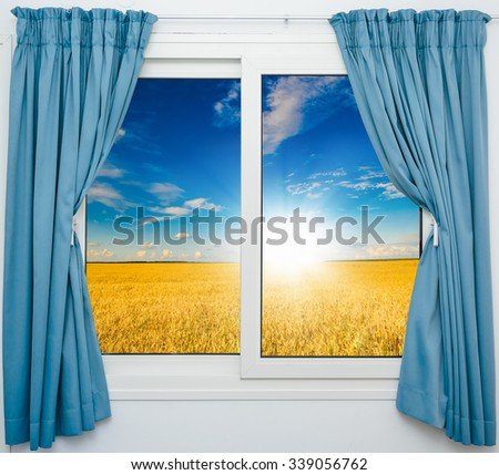 nature landscape with a view through a window with curtains - stock photo