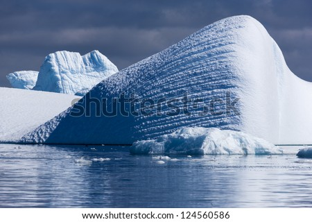 Nature of Antarctic Peninsula. Ices and icebergs. Travel on deep pure waters among glaciers of Antarctica. Fantastic snow landscapes. - stock photo