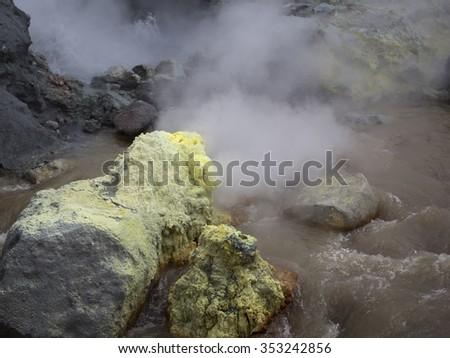 Nature of Kamchatka: sulfur fumarole in crater active Mutnovsky Volcano. Russia, Far East, Kamchatka Peninsula. - stock photo