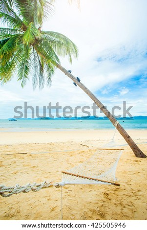 Nature of The cradle under tree beside the beach,Nature of beach,Nature of sea,Nature of beach,vacation,outdoor