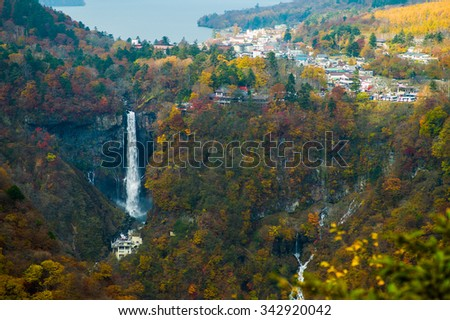 Nature of The Kegon Falls near Nikko, Japan surrounded by autumn color with Lake background - stock photo