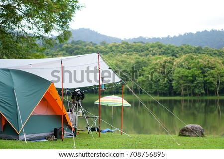 nature orange with green c&ing tent and gray fly sheet with tent accessory on meadow with & Nature Orange Green Camping Tent Gray Stock Photo 708756895 ...