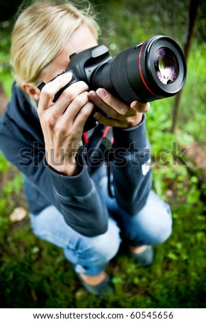 Nature photographer at work - stock photo
