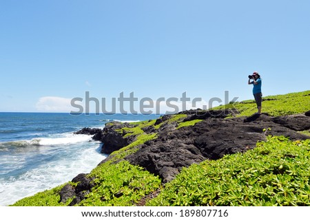Nature Photographer taking pictures outdoors,maui,hawaii. - stock photo