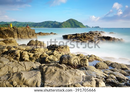 Nature scenery at Selong Belanak Beach, Lombok, Indonesia. Travel and Nature Concept. Long Exposure Motion Blur. - stock photo