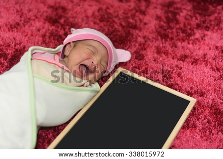Nature smile baby or Newborn baby peacefully sleeping with blackboard - stock photo