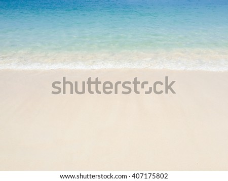 Nature Wave of the sea on the sand beach background - stock photo