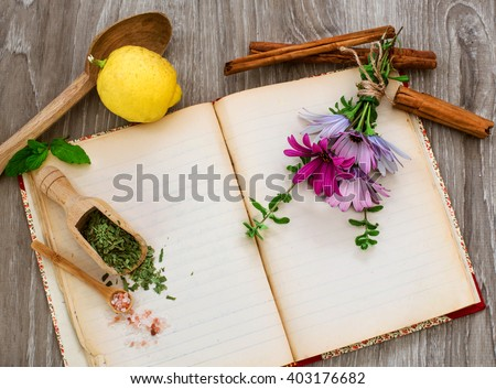 naturopathy concept with medical herbs and flowers