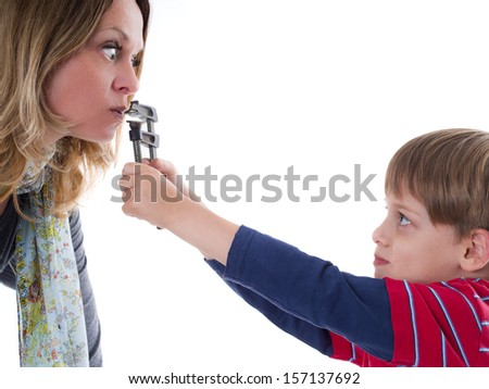 Naughty child does not allow his nervous mother to talk - young rebel - stock photo