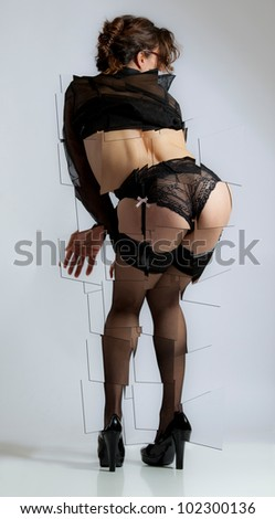 Naughty schoolteacher in black lingerie - stock photo