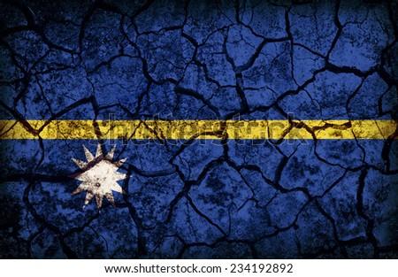 Nauru flag pattern on the crack soil texture ,retro vintage style - stock photo