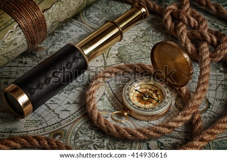 Nautical background with a navigation tools: telescope, compass and old maps - stock photo