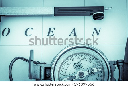 Nautical chart with compass and dividers - stock photo