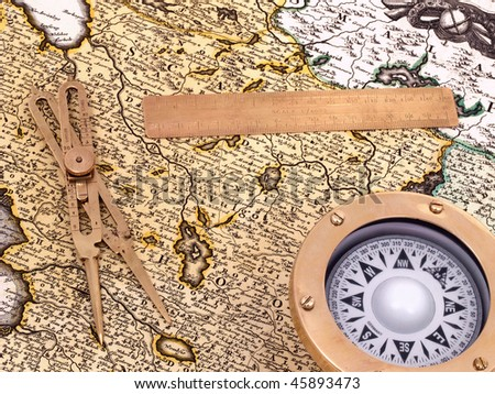 Nautical instruments on a map from XVIII century. - stock photo