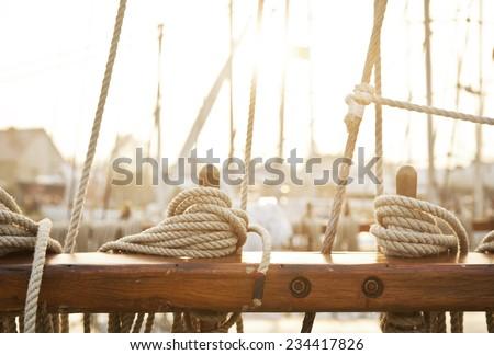 Nautical mooring rope, sunset light - stock photo