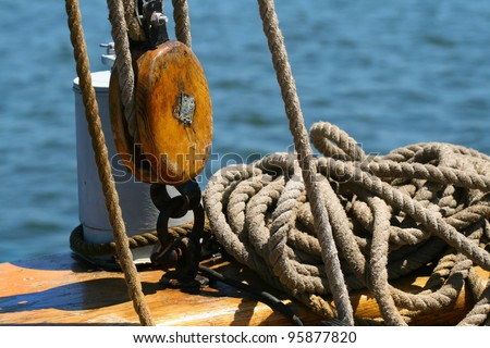nautical pulleys with ropes on the deck of a ship old - stock photo