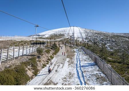 NAVACERRADA - JANUARY 4, 2015: Chair lift in Navacerrada Ski Resort, Navacerrada Mountain Pass, Madrid, Spain, on January 4, 2015 - stock photo