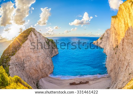 Navagio beach with shipwreck against colorful sunset on Zakynthos island in Greece - stock photo