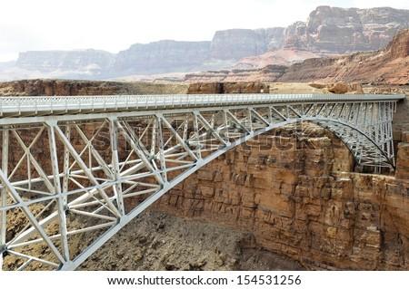 Navajo Bridge - Steel Arch Bridge over Colorado River, Arizona (USA) - stock photo