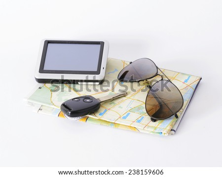 Navigator and sunglasses and car key on map for travel trip concept - stock photo