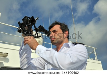 navigator with sextant on the watch on sea going vessel - stock photo
