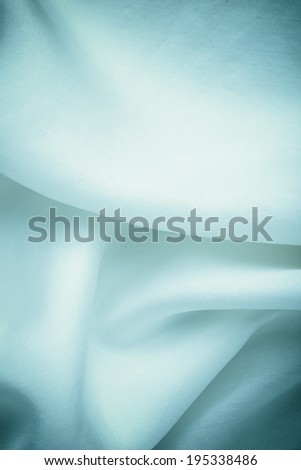 Navy blue cloth. Folds of silk elegant textile fabric as background texture wallpaper. - stock photo