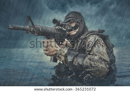 Navy SEAL frogman with complete diving gear and weapons in the water  - stock photo