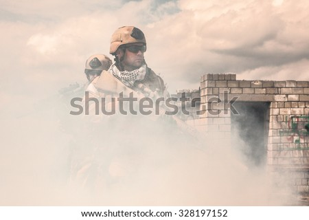 Navy SEALs Team with weapons in action  - stock photo