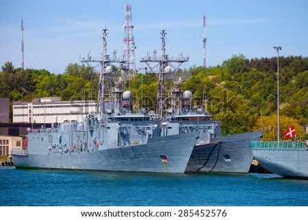 Navy warship moored at the wharf in the port of Gdynia, Poland. - stock photo