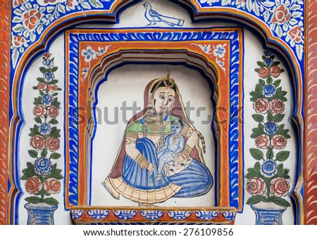 NAWALGARH, INDIA - FEB 6: Mother and baby Krishna in flowers on the old Havelis mansion fresco on February 6, 2015. With population of 100,000, Nawalgarh is the education center of Shekhawati region