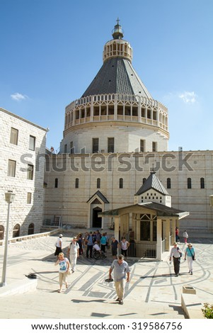 NAZARETH-SEP 23 : People walking,close to the Basilica of the Annunciation,on September 23, 2014 in Nazareth, Israel.This church stands in the site that was believed to be the house of Mary - stock photo