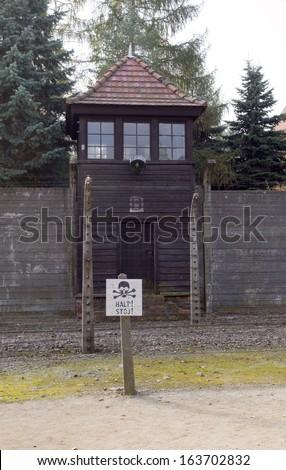 Nazi guard tower house by barracks Auschwitz German Nazi concentration camp Auschwitz-Birkenau Museum Poland - stock photo