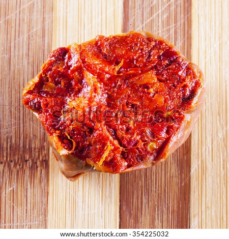 Nduja, typical Italian sausage, in close up, over wooden chopping board, square image - stock photo