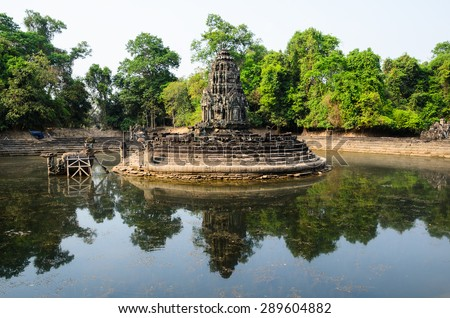 Neak Pean, part of Khmer Angkor temple complex, popular among tourists ancient landmark and place of worship in Southeast Asia. Siem Reap, Cambodia. - stock photo