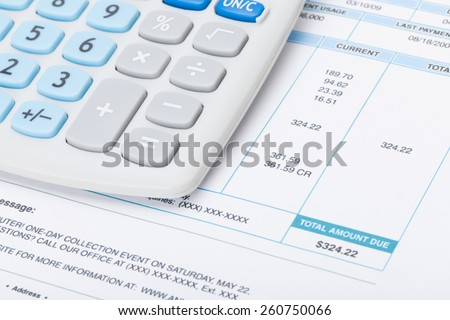 Neat calculator with utility bill under it