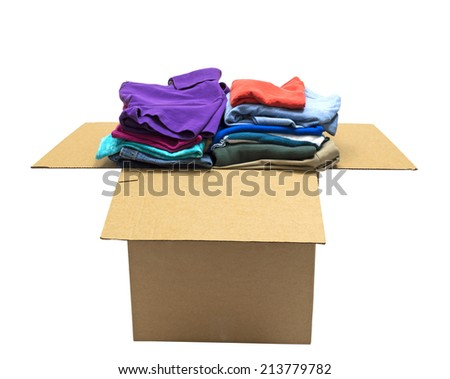 Neatly Folded Clothes In Box/ Isolated On White/ Focus On Front - stock photo