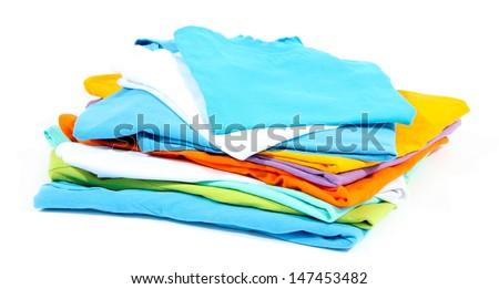 Neatly folded shirts isolated on white - stock photo
