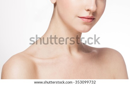 Neck Lips shoulders Beautiful woman face close up portrait young studio on white - stock photo