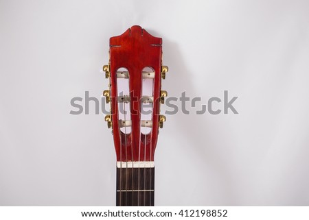 neck of the guitar on a white background, stringed musical instrument, parts of musical instruments, tune the guitar  - stock photo