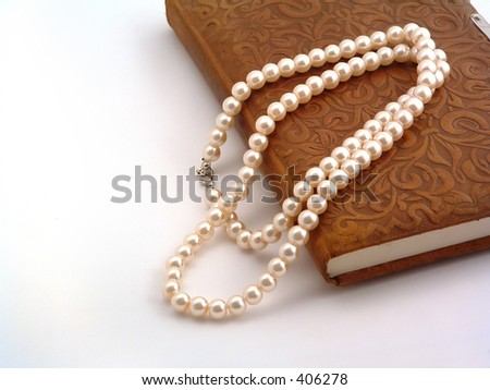 necklace and old fashioned diary - stock photo