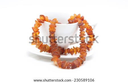 Necklace from amber to white cup - stock photo