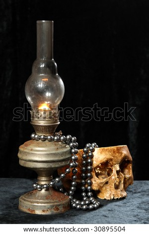 NECKLACE FROM PEARLS on an oil lamp - stock photo