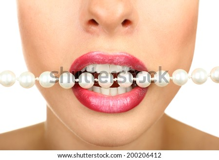 Necklace in teeth, close up - stock photo
