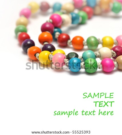 Necklace made of colorful beads isolated on white - stock photo