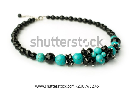 necklace of turquoise and black onyx isolated on white - stock photo