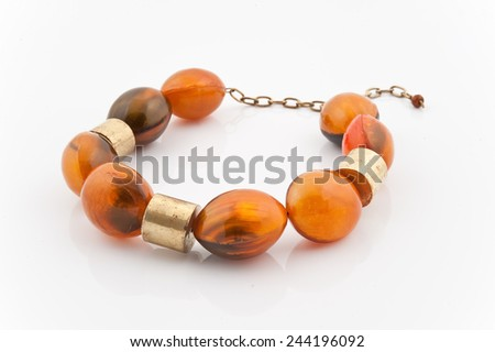 Necklace with amber isolated on white - stock photo