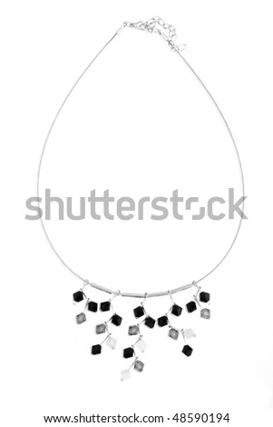 Necklace with black, grey and white crystals isolated on white.