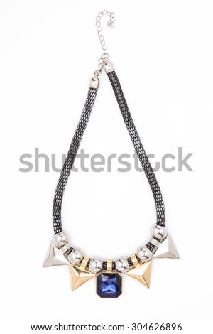 Necklace with blue gems and gold on a white background - stock photo